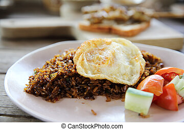 Fried rice nasi goreng with chicken and vegetables