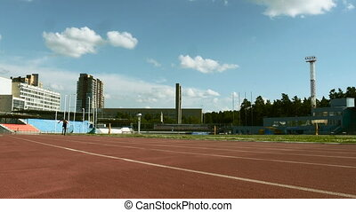 male athlete amputee running track stadium