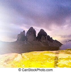Tre Cime di Lavaredo, Dolomites peaks at night.