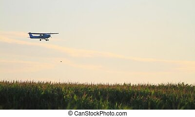 plane flies against the backdrop of the sunrise,The plane...