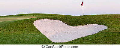 Heart shaped sand bunker in front of golf green - Heart...