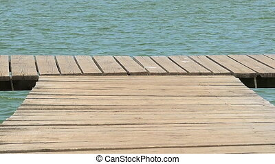 walking steps on a wooden pontoon