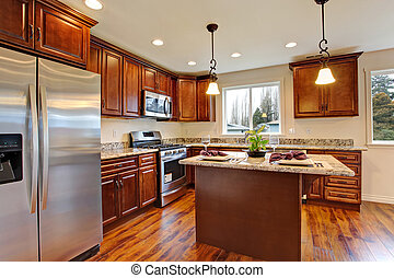 Kitchen with hardwood floor and granite counter tops.