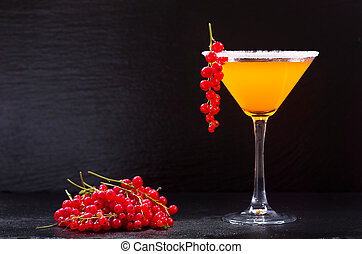orange cocktail with red currant