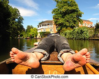 Barefoot man relaxing on boat - Barefoot man reveals the...