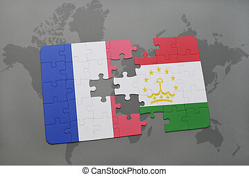 puzzle with the national flag of france and tajikistan on a...