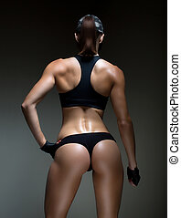 Perfect forms. Cropped studio shot of a stunning hot sporty...