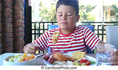 Child having breakfast - Child having breakfast at...