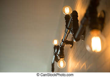 Decorative antique style light bulbs against brick wall...