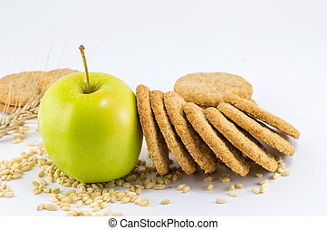 Integral biscuits with apple and wheat seeds on white...