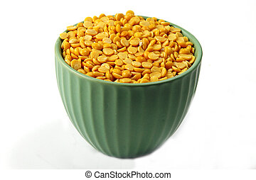 Arhar lentil seeds in a container on white background.