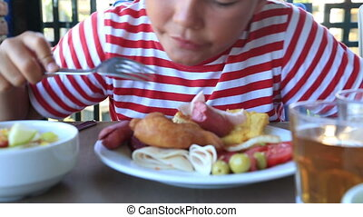 Child Eating Breakfast In A Restaurant