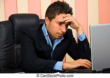 Stressed businessman browsing internet - Stressed...