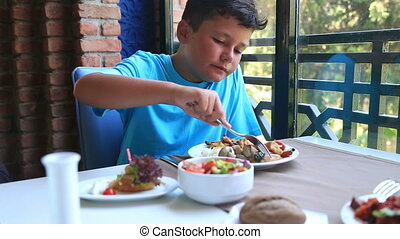 Child Eating Lunch In A Restaurant