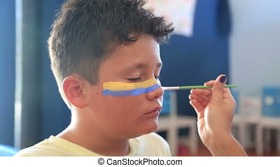 Face painting of a child - Body Art Painting On Little Boy...