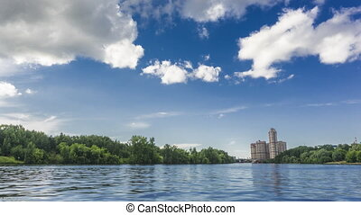 Moscow riversides, speedboat and dramatic summer clouds 4K...