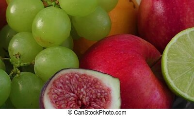 Assortment of exotic fruits on wooden table