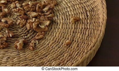 Walnut kernels in basket and whole walnuts