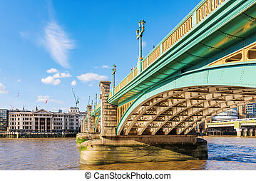 Southwark bridge with blue sky