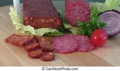 Salami on a cutting board - Sausage of salami on a cutting...