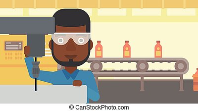 Man working on milling machine. - An african-american man...
