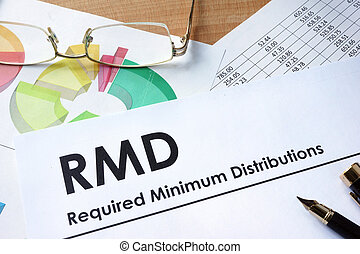 RMD required minimum distributions - Paper with words RMD...