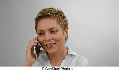 Short hair blond woman talks by mobile phone - Short hair...