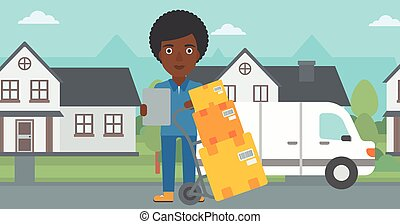 Delivery woman with cardboard boxes - An african-american...