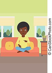 Happy pregnant woman - An african-american pregnant woman...