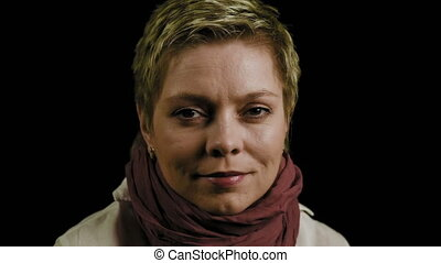 Pretty short hair woman looks straight to camera - Face...