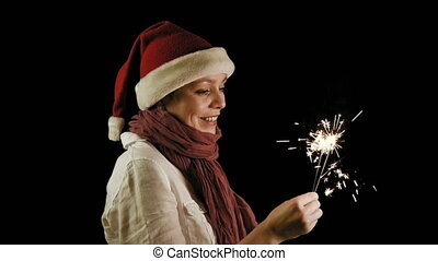 Pretty woman in red Christmas Santa with Sparklers