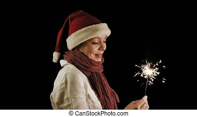 Pretty girl in red Christmas Santa with Sparklers - Pretty...