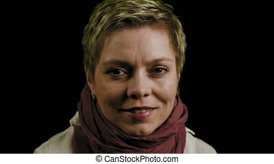 Pretty short hair woman looks straight and smiles - Face...