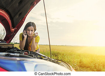 Woman and broken car - Woman calling emergency service near...
