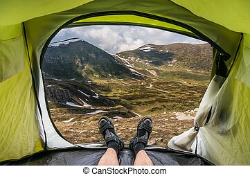 View from inside a tent on the mountains