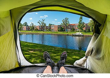View from inside a tent on the houses and channel