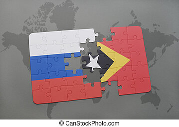 puzzle with the national flag of russia and east timor on a world map background.
