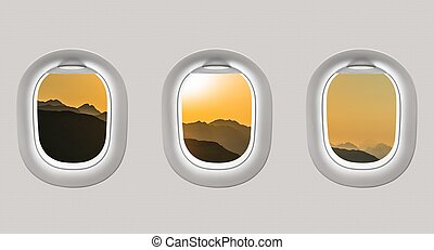 Looking out the windows of a plane to the mountains and...