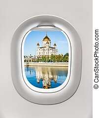 Looking out the window of a plane to the cathedral in Moscow