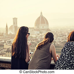 People at sunset watching the view of Florence. - People at...