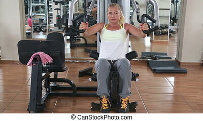 Woman In Fitness Center - Woman Working Out In Fitness...