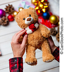child hands holding a teddy bear - photo of the child hands...