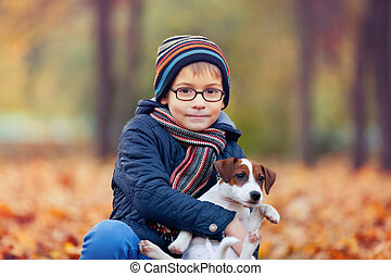 boy and his pet - portrait of the little boy playing with...