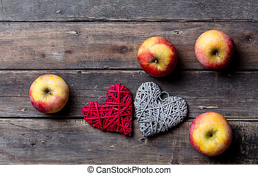 apples and heart shaped toys - photo of the delicious apples...