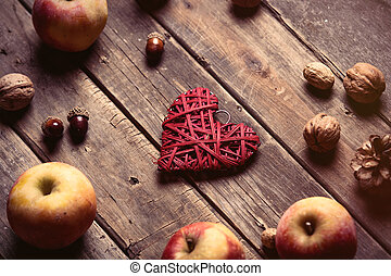 apples, heart shaped toy, fir-cones and nuts - photo of the...