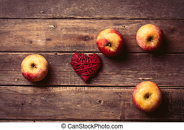 apples and heart shaped toy - photo of the delicious apples...