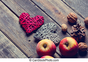 apples, heart shaped toys, fir-cones and nuts - photo of the...