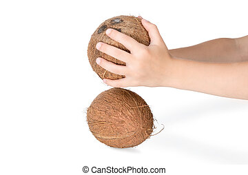 Beat the coconut against each other - Two hands holding a...