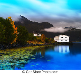 Horizontal vivid Norway autumn landscape with reflections...