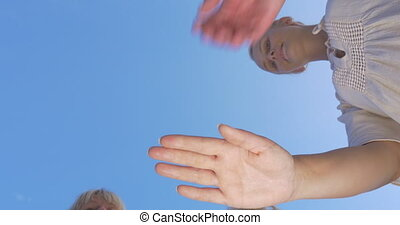 People making stack of hands - Bottom shot of young and...